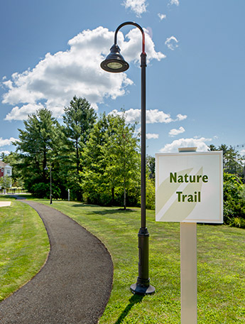 Wooded nature trail with outdoor fitness stations
