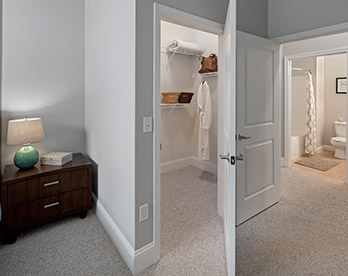 Walk-in closet in bedroom of Village at Taylor Pond apartment
