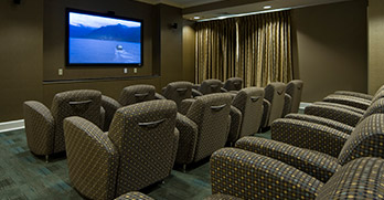 Residents' movie theater with 80-inch 3-D TV screen